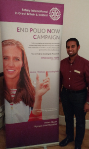 President Nominee Jason Chauhan with a Rotary End Polio Now poster featuring double Olympic champion rower Helen Glover
