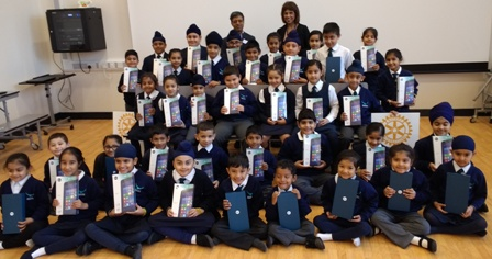 Headteacher Jasbir Mann and Rotary Club Vice President Deepak Karia with children holding the donated tablet PCs. Please click on the photo to hear their thanks
