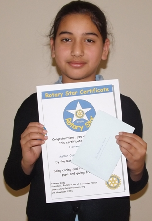 Harlanpreet Kaur, winner of a £5 gift voucher for being caring and thoughtful towards a new pupil and giving friendly support
