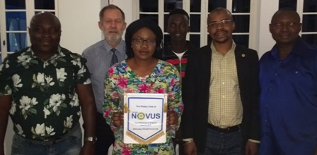 Rotary Club of Brusubi member Fatoumata with the Novus banner flanked by Rotarians Cornelius, Martin and Michael. Behind them is visiting businessman Christian Jorgensen and student Mbuba