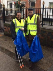 Anoushka Jethwa and Jim Matthews with litter-picker devices