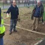 Project manager Matthew Herbert explains the next task to John Niblett and others