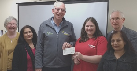 Paul Bonnett receives a cheque for the Air Ambulance from President Gemma and members