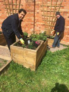 Pradeep and Frazer pause from planting