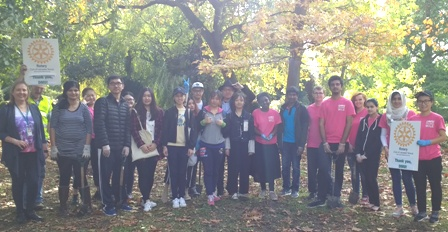 De Montfort University students take a break from planting crocus bulbs to pose for a photo