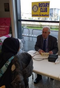 Bert Thurston gives advice to a shopper after he had taken her blood pressure