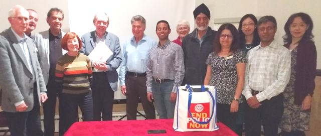 Guest speaker Roger Neuberg with President Jason Chauhan surrounded by Novus members and guests including Mai Tsumura and her mother Yuka on the right