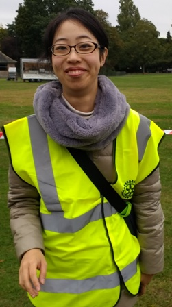 Mai Tsumura on duty wearing her Rotary Club of Leicester Novus hi-vis jacket