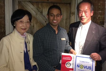 President Jason Chauhan exchanges banners with Rtn Shoji Yamamoto and his wife and Kazuko s