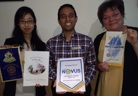 President Jason Chauhan flanked by Novus guests Mai Tsumura, from Japan, and Louisa Horne, from Canada
