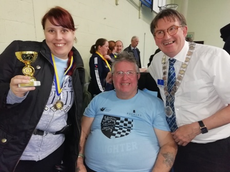 Winners Leatitia and Eddie after receiving their trophies from Rotary District Governor Tim Tucker
