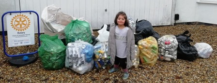 Isabela with 22 bags containing thousands of cans